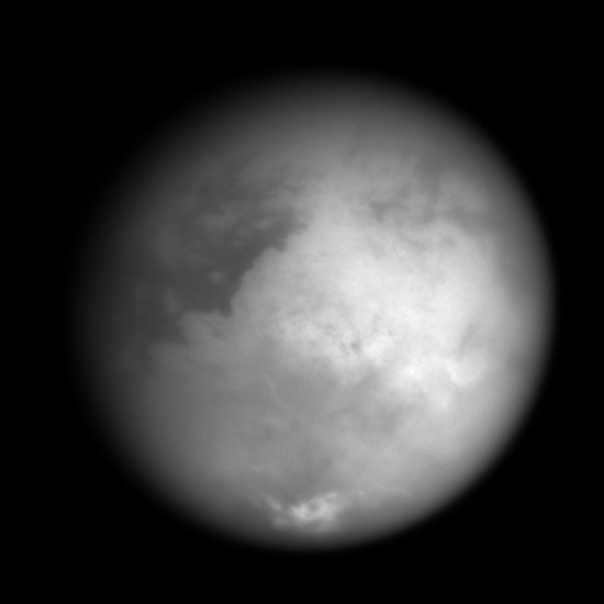 Grayscale view of Titan's surface; bright continent in middle of hemisphere